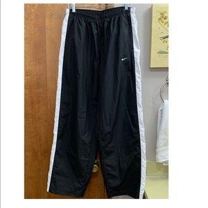 Men's black Nike track pants
